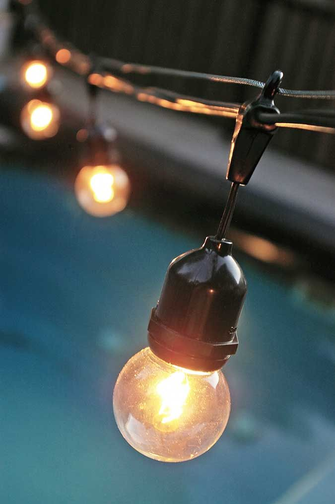 an explanation of how to hang your outdoor commercial grade globe string lights using a globe light suspension kit
