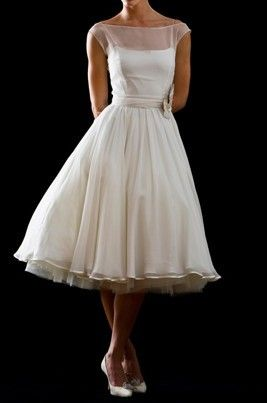 50s style wedding dress...What if I do something like this, in sage, with white gloves and a white sweater wrap (for the winter wedding theme),, and the white pill box birdcage hat? Or keep it white, with a colored cardigan, and just a tad less poufy?