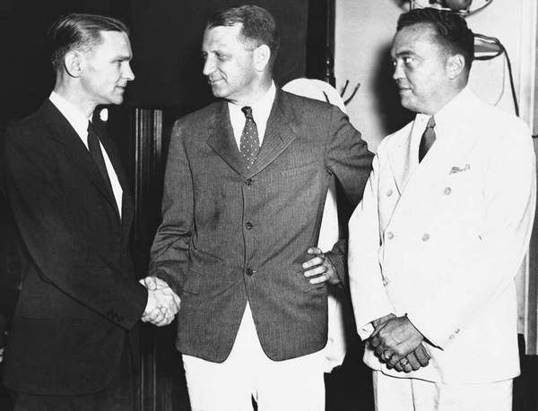 Clyde Tolson and Hoover publicly congratulate Melvin Purvis, the FBI's most successful agent. In private Hoover was hugely jealous of the attention Purvis received from the press, and forced him out of the agency as a result. Purvis eventually killed himself.