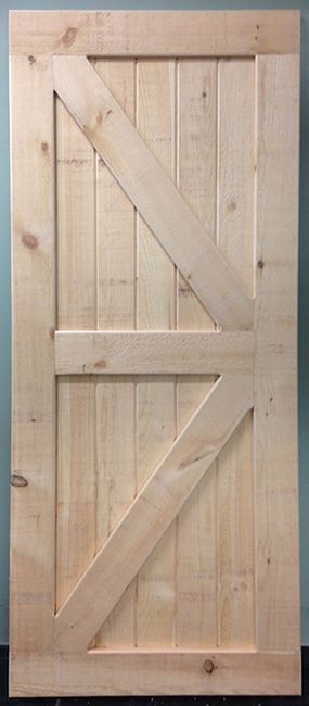 The Barn Door Hardware Store offers fully assembled British Brace sliding barn doors that are American handmade in Pennsylvania.