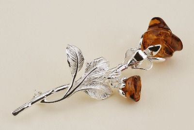 A rose amber and silver brooch four colours available.