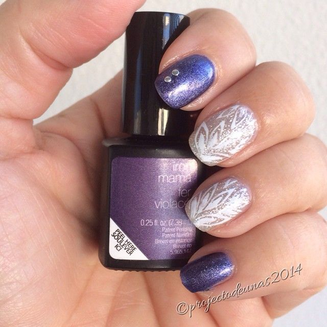 Some purple and silver glitter with stamping and little studs. Stamping plate @bundlemonster BM210, studs from @bornprettystore  gel nail polish  Iron mama and Silver glitter from @sensationailsuomi