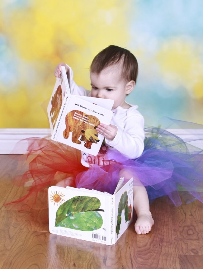One year old photography session reading books