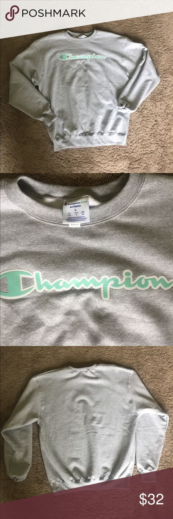 """BRAND NEW Champion sweatshirt 💚💙 This sweatshirt has never been worn 😍 there's just no tags because I was so sure I was gonna wear it. Bought online from Urban Outfitters. Perfect condition. Gray sweatshirt with mint green """"champion"""" on front. Men's large but will definitely fit oversized on a women's small-large. Champion Shirts Sweatshirts & Hoodies"""