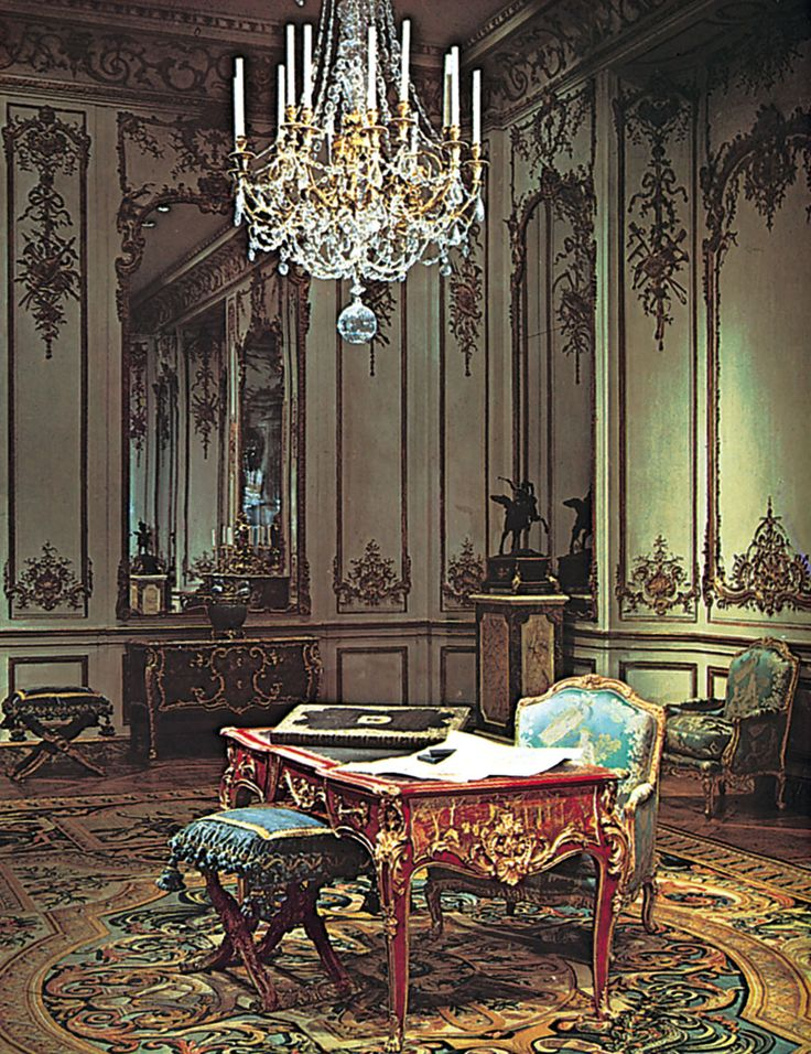 A delicacy of decorative motif in paneling and furniture characteristic of  the Rococo design of the