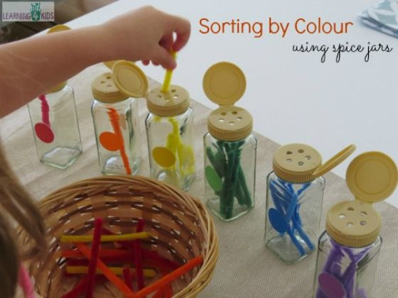 Sorting by colour using empty spice jars - this is a great activity for developing the pincer grasp, hand & eye coordination and concentration by learning 4 kids