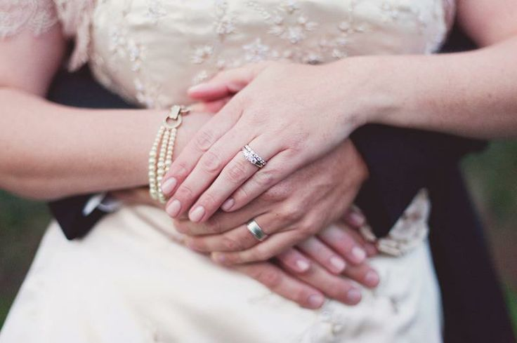 fall weddingsWedding Rings Holding Hands