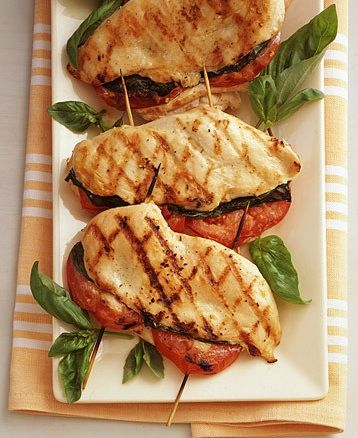grilled chicken stuffed with tomato & basil...  o.. m.. g..  (i think i'd add a little fresh mozzarella, but that's just my cheesemonger side talking).