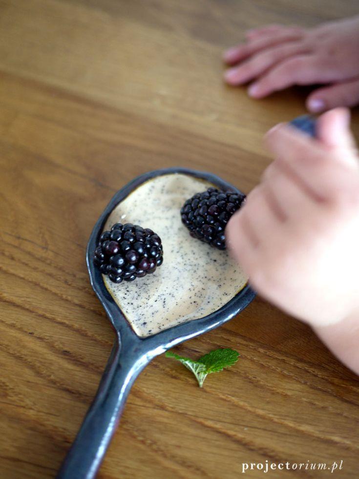 blackberries in the black and white ceramic spoon