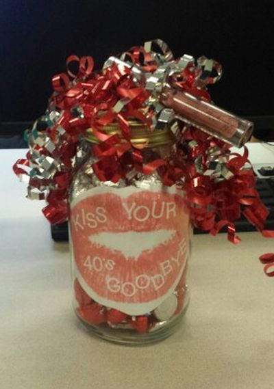 Kiss your 40's goodbye with a Mason jar filled with candy kisses.  See more 50th birthday gag gifts and party ideas at www.one-stop-party-ideas.com