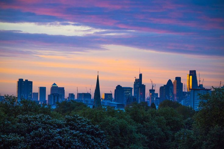 The mercury has been steadily climbing in London all week, and it looks set to be one of the hottest May Bank Holidays in a century, with temperatures predicted to hit the 33C mark by the weekend. And with every heatwave, comes a series of very pretty sunrises. A quick scroll through your Instagramfeed will show how Londoners - and everyone around the UK - have been getting snap happy at sunrise, competing to capture the skies in all their multi-colour glory.
