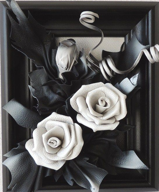 Handcrafted Leather Wall Hanging Art - Black & White Leather Roses  Every Artwork takes a lot of time and work, beautiful design with highest quality.  Elegant and fine construction enrich your home or office.     Black & White Leather Roses  Size: 12in by 9in (28cm x 23cm)  Frame: Solid Wood Stained Black  Colors: Black & White  Material: Genuine Leather