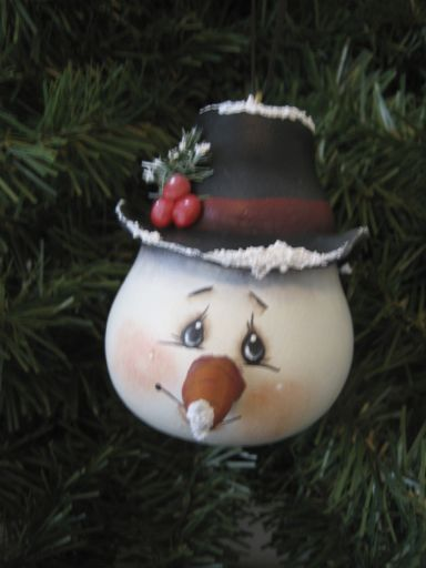 Love the details on this painted snowman's face!