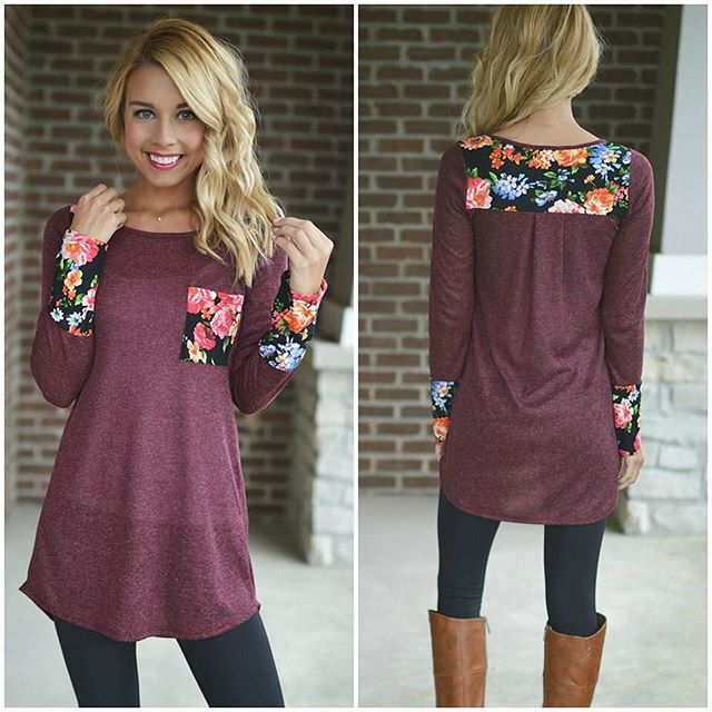 Love this tunic! The color is gorgeous and I love the flower detailing