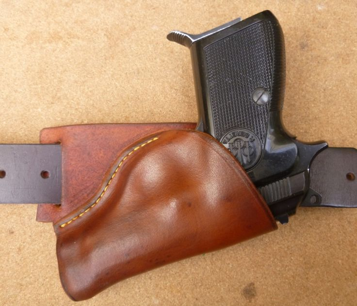 Angled Small of Back (SOB) carry holster for Beretta 70 series automatic pistols. Custom leather holsters for older automatics are a makeitjones specialty. Hand crafted to order from www.makeitjones.co.uk