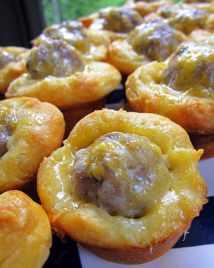 Sausage Biscuit Bites - 2 (10 count) cans flaky biscuits (Grands Jr) 1 lb sausage  2 cups shredded cheddar cheese.