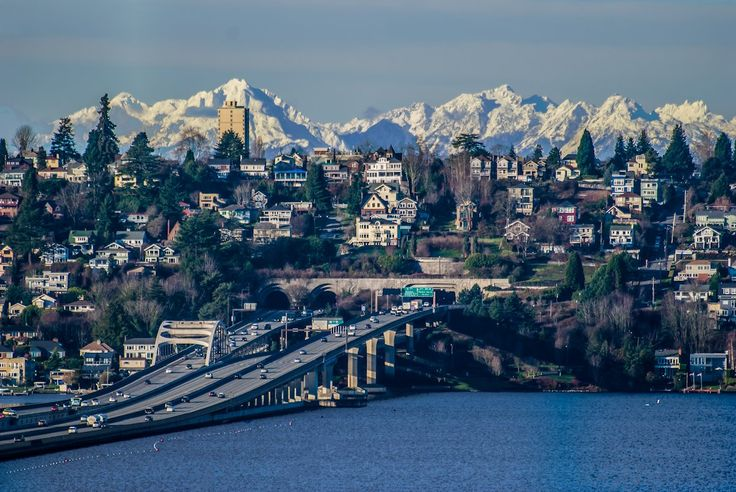 The I-90 floating bridge across Lake Washington, leading into the Mount Baker tunnel on the way to Seattle, Washington. Olympic mountains in the background.