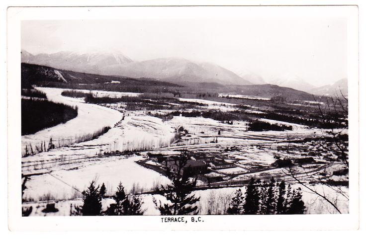 A photo postcard, which shows a panorama view of Terrace from a nearby hillside, with Skeena River at left.