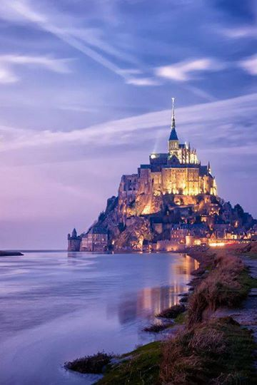 Mont Saint-Michel, France. this chateau becomes an island at high tide