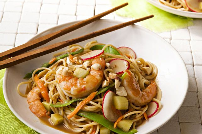 Toasted sesame dressing, peanut butter and soy sauce give this delicious shrimp and vegetable pasta stir-fry its Asian-inspired flavor.