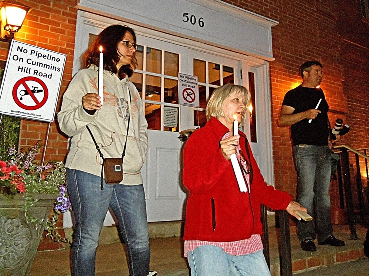 photo by Charles Reynolds    Jolie DeFeis, Tracey Hoffman and Carlos Torres lead the group  protesting Tennessee Gas Pipeline's decision to go through their neighborhoods. -