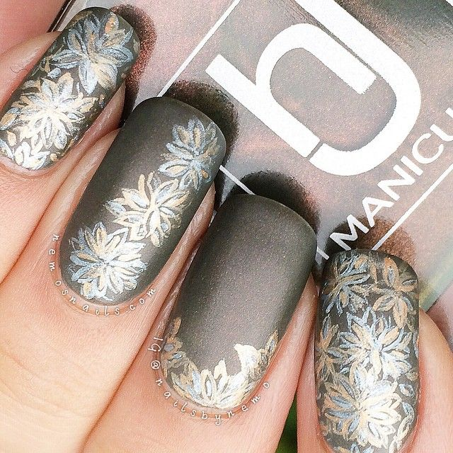 Instagram media by nailsbynemo - Matte version of my metallic flower nails. The bronze shimmer in the polish isn't as visible in the matte version but I think the nail art looks better. Polish is 'Vintage Bronze' by @hjmanicure. I used silver and gold acrylic paint for the flowers with my 000 brush from @winstonia_store and the top coat is 'Matte about you' by @essiepolish.