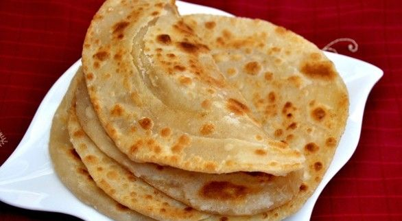 Ahh, the paratha – if you don't know what it is, it's  your lucky day! Originally from India, this delicious flatbread is one of the most popular side dishes in the region. Whether dipped in a savory curry, stuffed with potatoes and eaten by itself, or paired with hot tea, this unleavened little piece of heaven is super easy to make and is sure to be a hit with gastronomically adventurous guests at your next party.