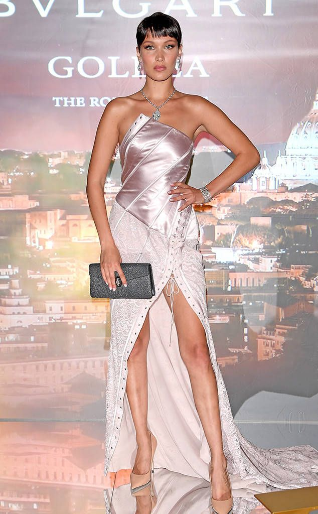 <p><strong>Bella Hadid</strong> is dressed to impress in vintage Galliano (with a pixie wig) to celebrate her new campaign for Bvlgari's latest fragrance, Goldea Roman Night, in Rome. The 20-year-old model dominates in just about anything, and this champagne-pink gown is no exception. The only thing amiss here are those nude pumps; a sexy sandal would have been a much better fit here.</p>