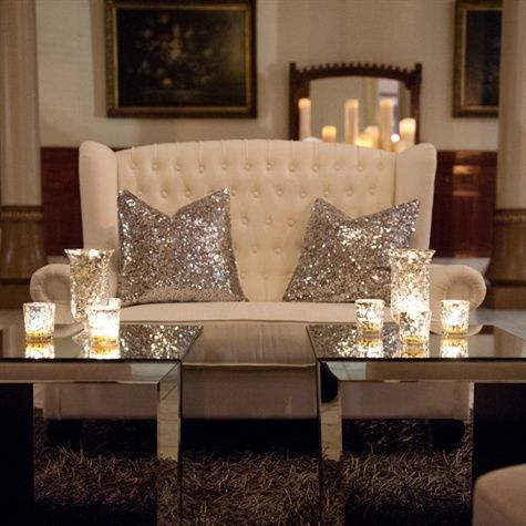 love the 2 separate mirror tables w candles and sparkly pillow in back to reflect the light :) pretty