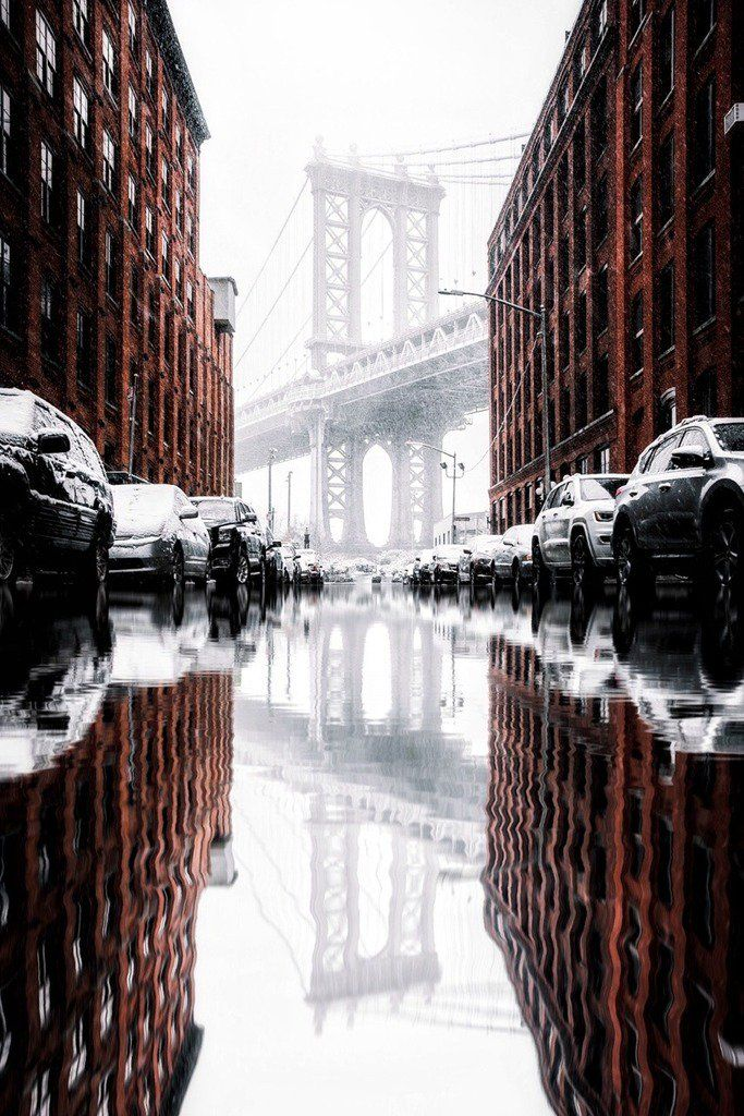 Brooklyn Bridge reflected on a flooded road