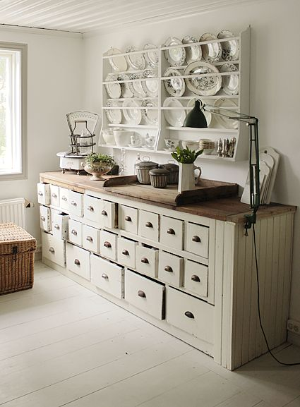 This is what I want in the garden shed. Full open shelves at top though--for storing smaller pots.  A knee hole area for a stool.