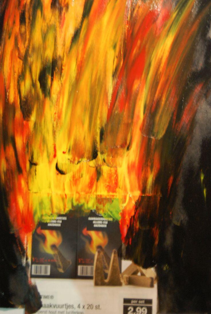 Het vuur aan de aanmaakblokjes dynamischer gemaakt door wat extra vlammen toe te voegen. Het hele blad staat in brand.