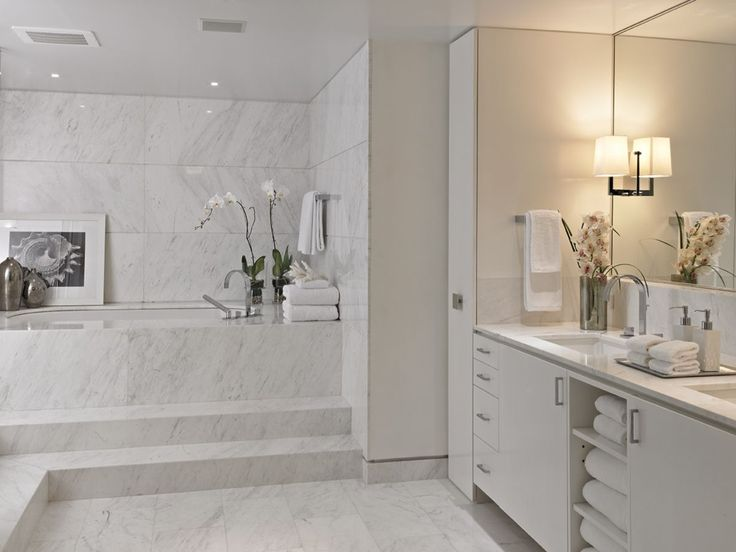 This stunning white bathroom was completed in white Himalaya polished  marble by Marmol Export USA.