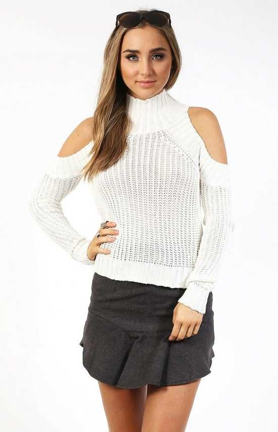 White Cut Out Sweater -   This must-have winter Sweater is made in a cosy cream cotton knit, featuring a high neck, cut out shoulders and a cropped fit.  $55.00