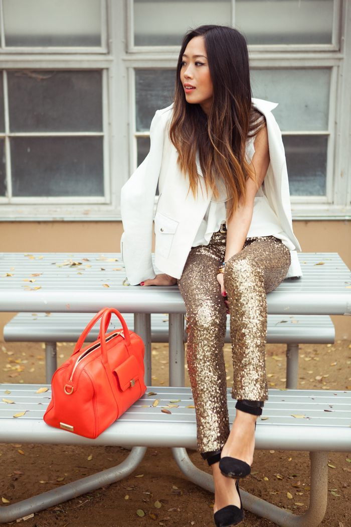 Pair a white blazer with gold sequin slim pants for both chic and easy-to-wear look. Round off this look with black suede pumps.  Shop this look for $163:  http://lookastic.com/women/looks/blazer-sleeveless-top-skinny-pants-duffle-bag-pumps/6104  — White Blazer  — White Silk Sleeveless Top  — Gold Sequin Skinny Pants  — Red Leather Duffle Bag  — Black Suede Pumps