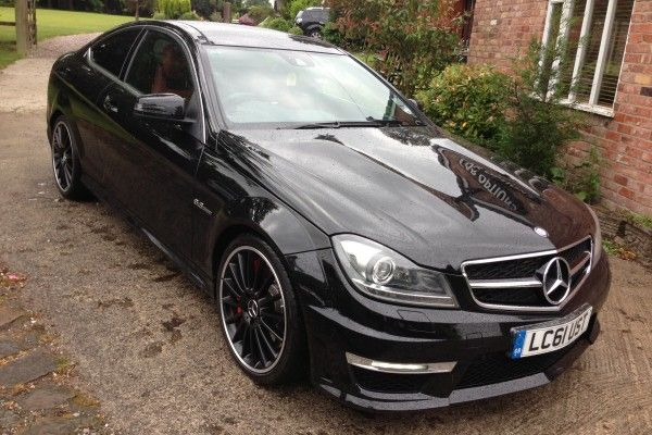 """USED MERCEDES-BENZ C CLASS AMG COUPE (2011-Present) #usedcars £44,950.00 Metallic Black, Reversing Camera,Panoramic Roof,Memory Seats,Two-tone leather,Xenon LED lights,, Upgrades - Reversing camera, 19"""" AMG multi spoke alloy wheels painted black, Designo two tone leather upholstery, Standard Features & much more."""