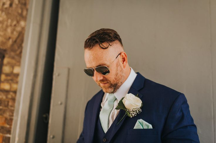 Don't forget the shades on a sunny day. Photo by Benjamin Stuart Photography #weddingphotography #groom #suit #buttonhole #shades #weddingsuit #3piece #weddingday