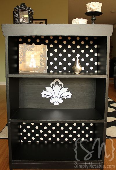 What a cute and easy way to make a simple black bookcase chic. I've had some toile contact paper for a while. Now I know what to do with it!
