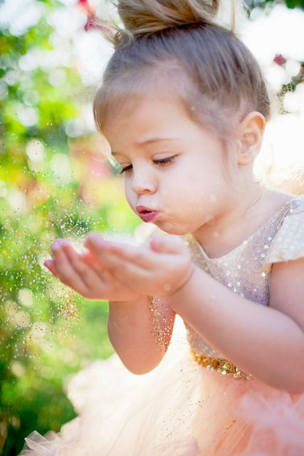 Blowing glitter :) This would be so cute for a toddler's birthday photo session.