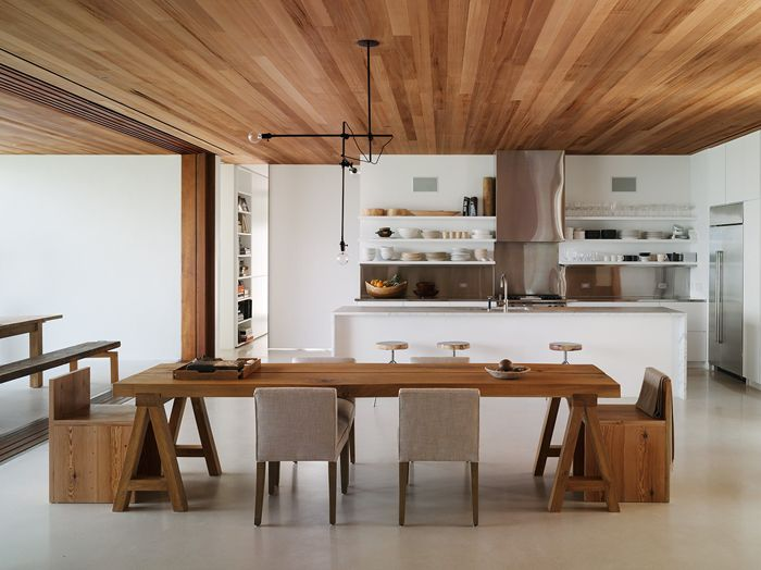 light wooden ceiling with light polished concrete floor
