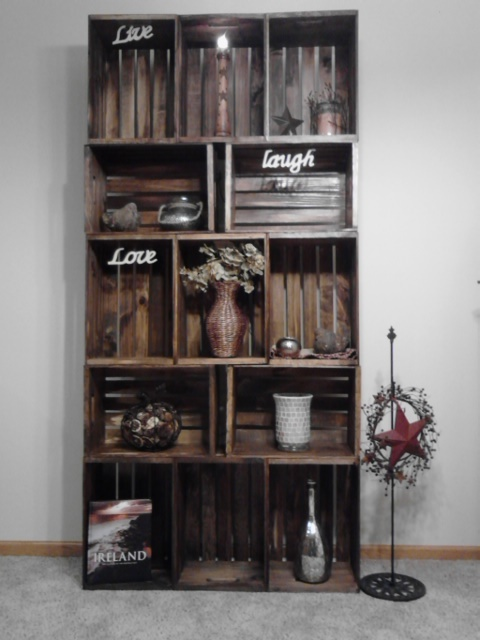 wooden apple crates. Saw some at walmart that are unfinished but with a dark stain could look like this. Hmmm