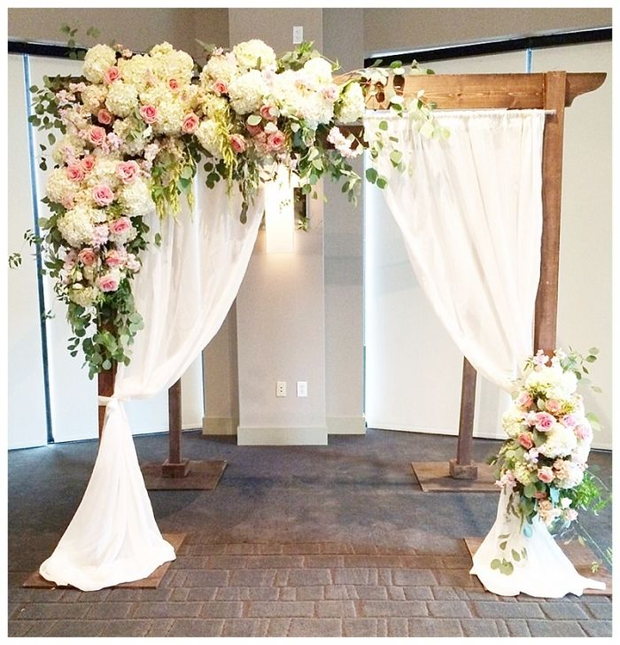 Pretty wedding arch for an outdoor wedding.if wanting to save money hydrangeas could be used since their blooms are so large