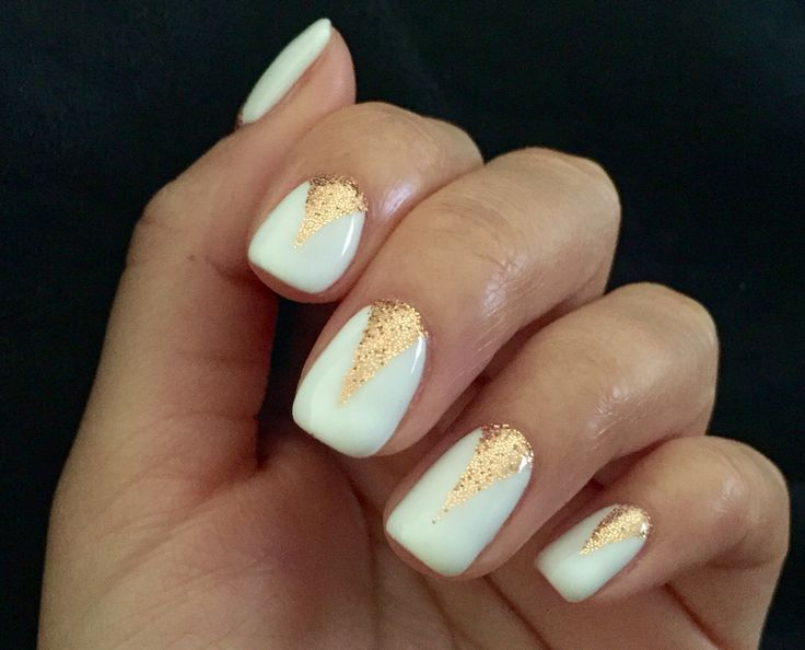 Rose gold glitter triangle on white nail beds. Simple with a touch of glam. Obsessed!