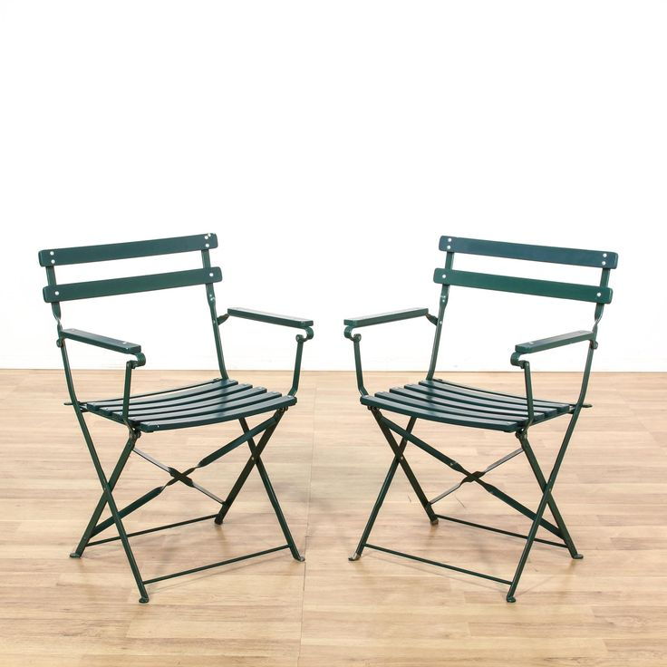 "This pair of ""Pottery Barn"" chairs are featured in a durable metal with a glossy dark green finish. These outdoor chairs have folding bases with curved slat seats and simple arms. Perfect country farmhouse chairs for a garden or patio! #countryfarmhouse #chairs #foldingchair #sandiegovintage #vintagefurniture"