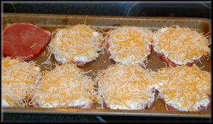 Cheesy Pork Chops  •boneless pork chops   •10 tsp sour cream  •seasoning salt  •2 cups shredded cheese    line the pan with your chops and sprinkle with your favorite seasoning.    2) smother with 1 tsp sour cream per chop    ) add enough shredded cheese to cover the top.    4) bake at 350. Adjust the cooking time to the thickness of the meat. Thin pork chops are done in 15 minutes. For an inch and a half of chop, I'd bake for 35 – 40 minutes.