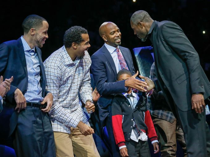 (From left) Former Pistons Tayshaun Prince, Rasheed Wallace & Chauncey Billups shake the hand of Ben Wallace as his jersey is retired (01/15/16)