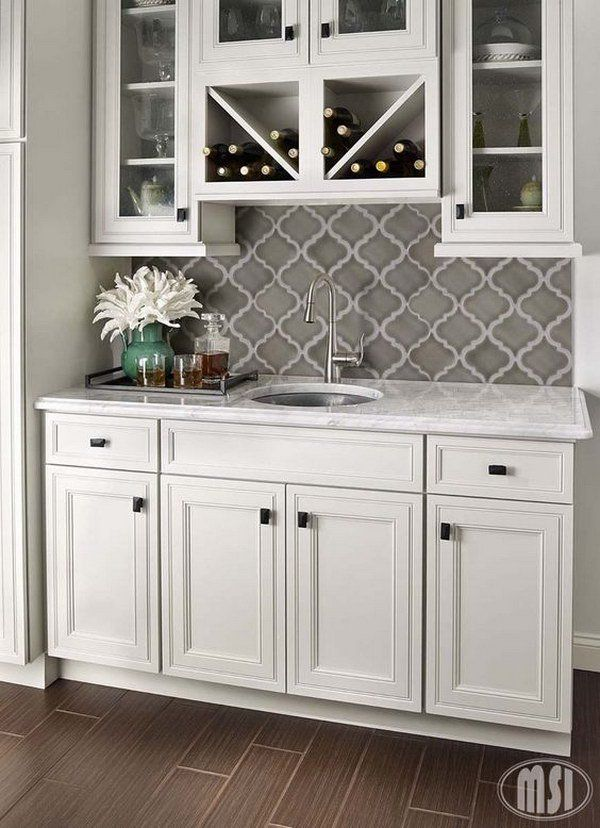 Grey Arabesque Shape Mosaic Tile Backsplash against White Cabinets