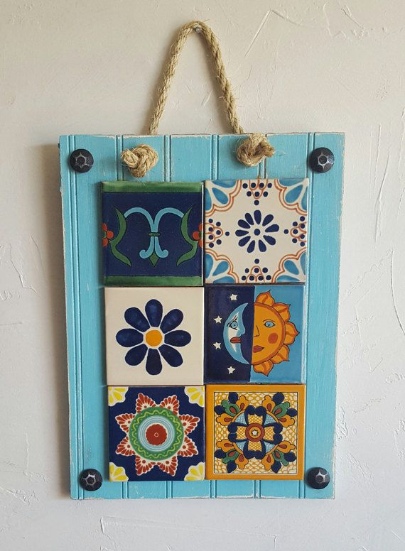 This rustic, handmade wall hanging is made with six individual Talavera tiles, and is perfect for those who adore rustic, southwestern decor! The wooden frame is distressed and hand painted. Large metal adornments in the corners add rustic charm. A larger hanging with 12 tiles is also available. Dimensions: 16 x 12