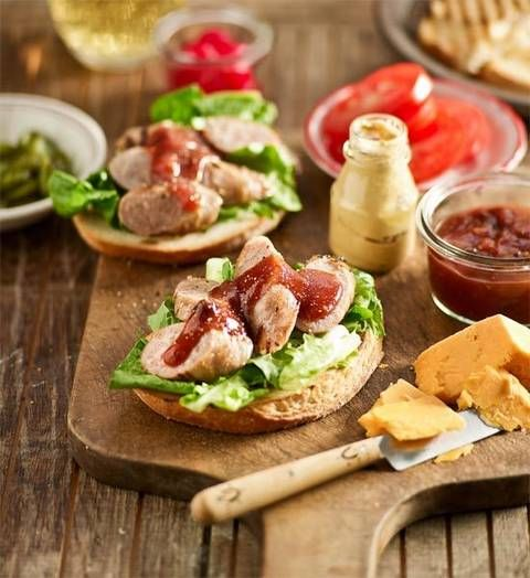 Ploughman's pork burgers: Like to mix things up a bit? Present these sausage burgers on a platter with salad, cheese, chutneys and sauces on the side, and let people pick what they like