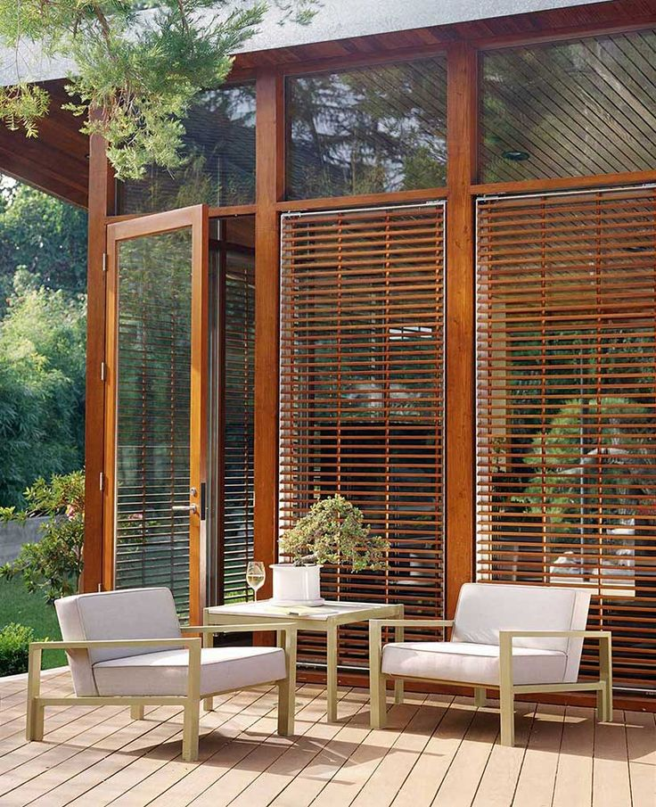 Stunning Outdoor Design With Wooden Deck And Glass Doors | Jamie Bush + Co.
